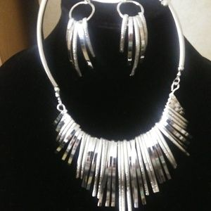 Two unique metal necklaces one silver and gold